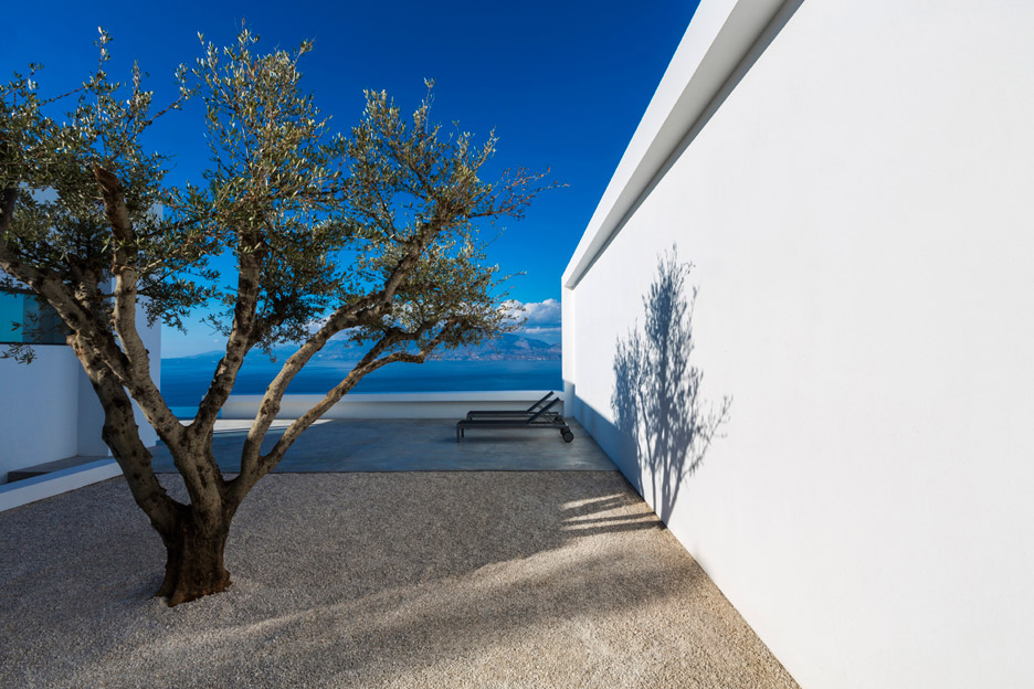 Stark white walls frame vistas of the Ionian Sea from a bright white house by Brussels-based architect Olivier Dwek.